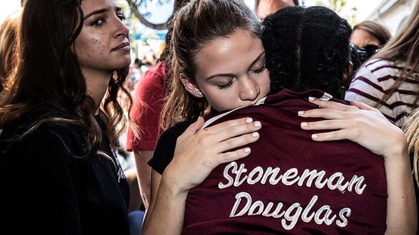Students from Marjory Stoneman Douglas High School attend a memorial following a school shooting incident in Parkland, Florida, U.S., February 15, 2018.  REUTERS/Thom Baur - RC1AFD9727E0