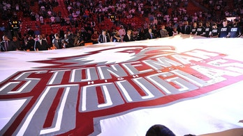 A large banner in memory of the victims of the Marjory Stoneman Douglas High School shooting is unfurled before an NBA basketball game in Miami on Saturday, Feb. 24, 2018, between the Miami Heat and the Memphis Grizzlies. (AP Photo/Gaston De Cardenas)
