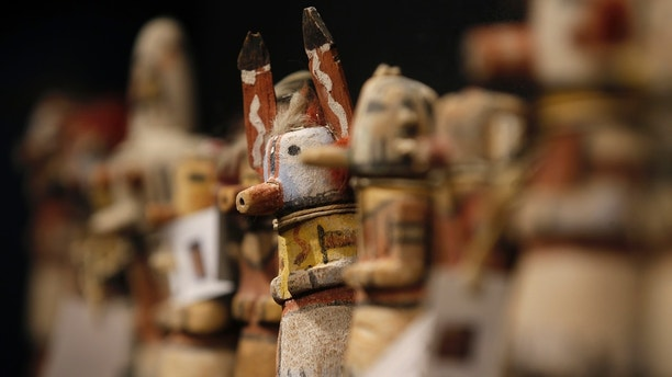 Kachina dolls made by the Native American Hopi and Zuni tribes are displayed at the Drouot auction house in Paris before auction, December 15, 2014.  The Hopi, some of whose 18,000 members continue to follow a traditional way of life farming on three isolated mesas, believe the bright, mostly fabric masks are imbued with the spirits of divine messengers.  REUTERS/Christian Hartmann (FRANCE - Tags: SOCIETY) - PM1EACF0ZV801