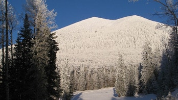 A cross-country skier, shown in shadow, makes his way across the lower slopes at Arizona Snowbowl near Flagstaff, Ariz,, Monday, Nov. 22, 2010 where between 6 and 10 inches fell Sunday. (AP Photo/The Arizona Daily Sun, Rand Wilson)