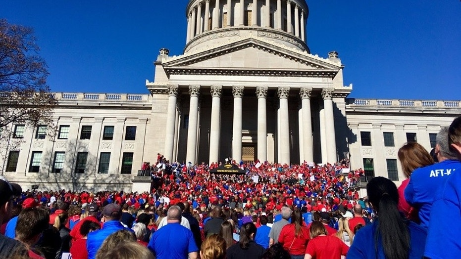 Striking teachers in West Virginia public schools would return to work on Thursday, the state's governor announced at a news conference Tuesday.