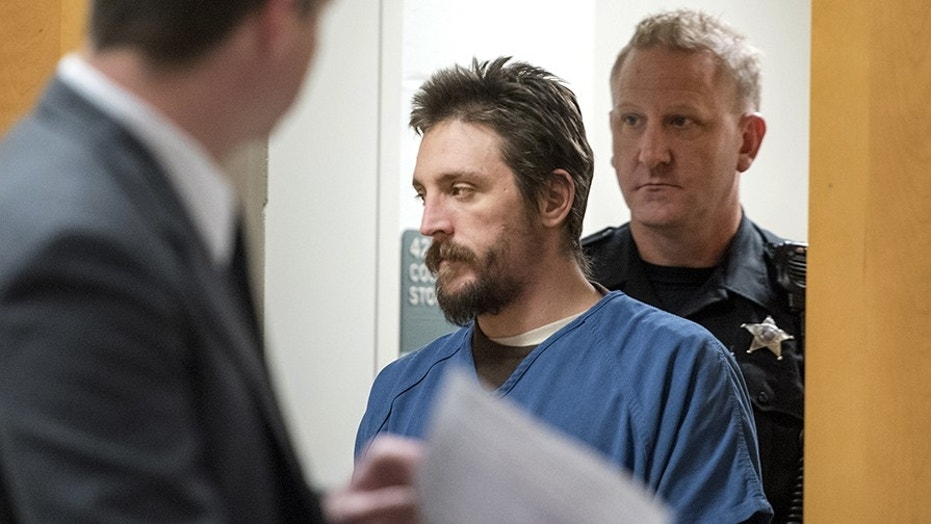 FILE - In this Oct. 19, 2017 file photo, Joseph Jakubowski is escorted into a courtroom at the Rock County Courthouse in Janesville, Wis. Jakubowski, who stole a cache of firearms from a gun shop and sent a rambling anti-government manifesto to President Donald Trump before going on the run, faces up to 20 years in federal prison when he is sentenced Wednesday, Dec. 20, 2017. (Angela Major/The Janesville Gazette via AP, File)