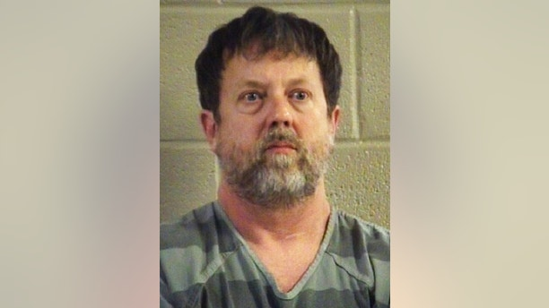 This undated photo provided by the Whitfield County Sheriff's Office shows Jesse Randal Davidson. Social studies teacher Davidson barricaded himself inside a classroom at Dalton High School in Dalton, Ga., Wednesday, Feb. 28, 2018, and fired a handgun, sending students running outside or hunkering down in darkened gym locker rooms, authorities said. (Whitfield County Sheriff's Office via AP)