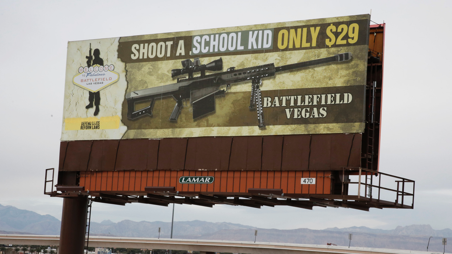 Art collective INDECLINE vandalizes shooting range billboard