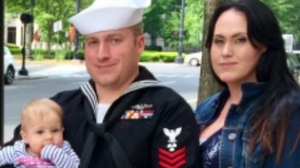 Trump pardons Navy sailor who took photos inside sub
