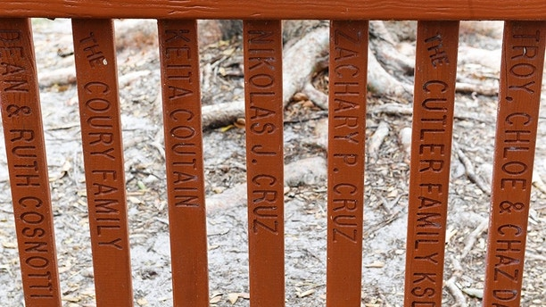 February 23, 2018 - Parkland, Florida USA: The names of suspected Florida gunman Nikolas Cruz and his brother Zachary Cruz appear in two slats in the fence surrounding a playground at Liberty Park, 9200 Ranch Road, Parkland, Fl. Friday, February 23, 2018. (Taimy Alvarez/Sun Sentinel/POLARIS) ///