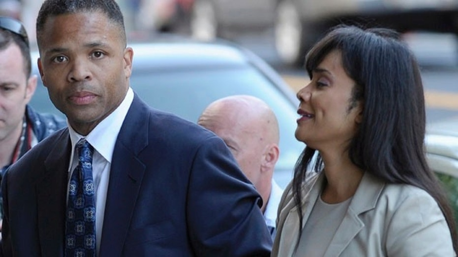 Former U.S. Rep. Jesse Jackson Jr. and his then-wife Sandi arrive at a courthouse in Washington, Aug. 14, 2013.