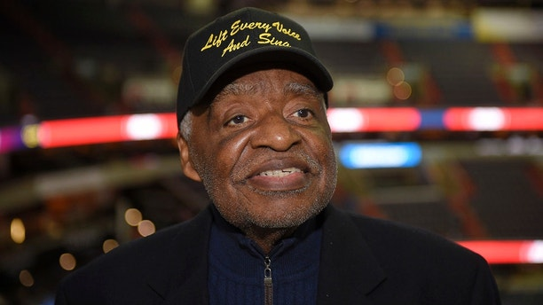 """Eugene Williams poses for a photograph before an NBA basketball game between the Washington Wizards and the Golden State Warriors, Wednesday, Feb. 28, 2018, in Washington. Several NBA teams have played what is known as the """"negro national anthem"""" at games during Black History Month thanks in part to the urging of Williams, a retired Howard University professor. (AP Photo/Nick Wass)"""