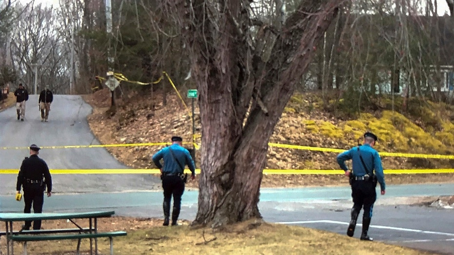March 1, 2018: Police search around a home in West Brookfield, Mass.