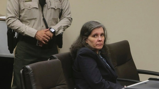 Louise Turpin appears in court for a conference about their case in Riverside, Calif., Friday, Feb. 23, 2018. A California couple already accused of starving and shackling some of their 13 children has pleaded not guilty to new charges of child abuse. David and Louise Turpin entered pleas Friday to three new charges of abuse. Louise Turpin also pleaded not guilty to a count of felony assault. (Watchara Phomicinda/The Press-Enterprise via AP, Pool)