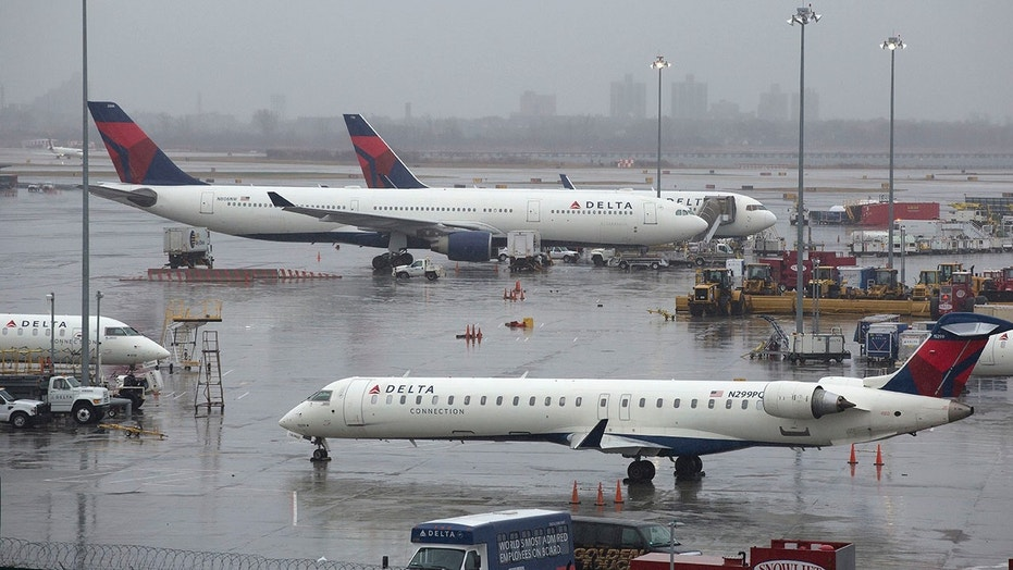 Delta planes sit grounded in New York City, March 2, 2018. Airlines canceled many flights as a severe storm arrived in the Northeast.
