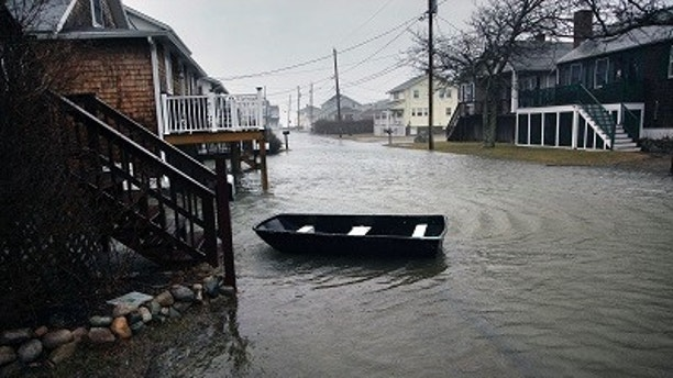 A Tenth Avenue home in Scituate, Mass., has a row boat tethered out front, Friday, March 2, 2018. (Gary Higgins/The Quincy Patriot Ledger via AP)