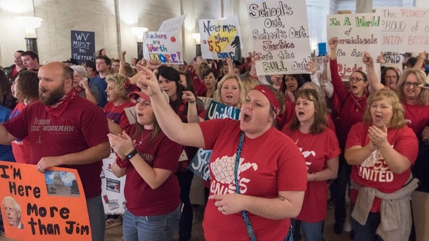 Hundreds of teachers and school personnel rally at the Capitol building on the fourth day of statewide walkouts in Charleston, W.V., on Tuesday, Feb. 27, 2018.   (Craig Hudson/Charleston Gazette-Mail via AP)