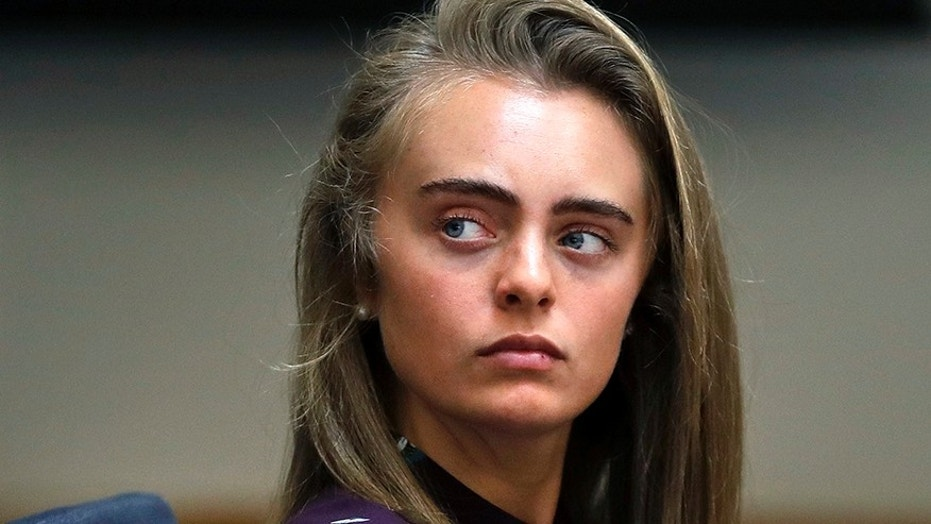 Defendant Michelle Carter listens to testimony at Taunton District Court in Taunton, Mass., in Taunton, Mass., Thursday, June 8, 2017. Carter is charged with involuntary manslaughter for encouraging Conrad Roy III to kill himself in July 2014. (AP Photo/Charles Krupa, Pool)