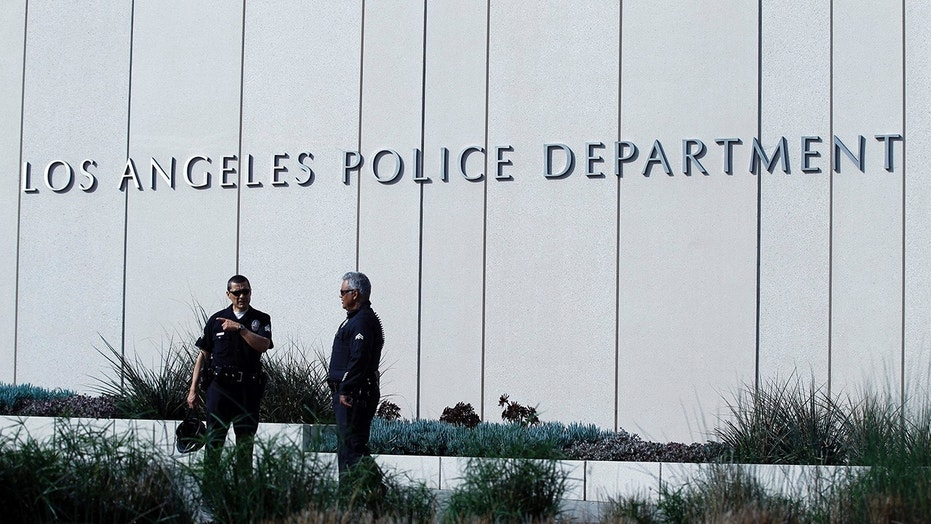 A Los Angeles police officer was being hailed as a hero Saturday for reviving an unresponsive 3-week-old baby after infant's father allegedly slammed the child on the ground, authorities said.