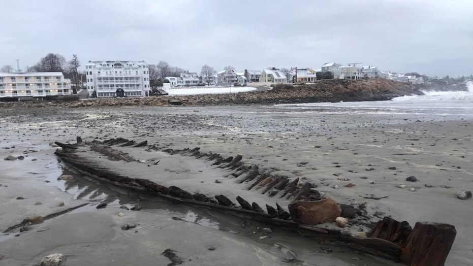 The shipwreck, believed to be more than 160 years old, resurfaced on Short Sands Beach Monday morning.