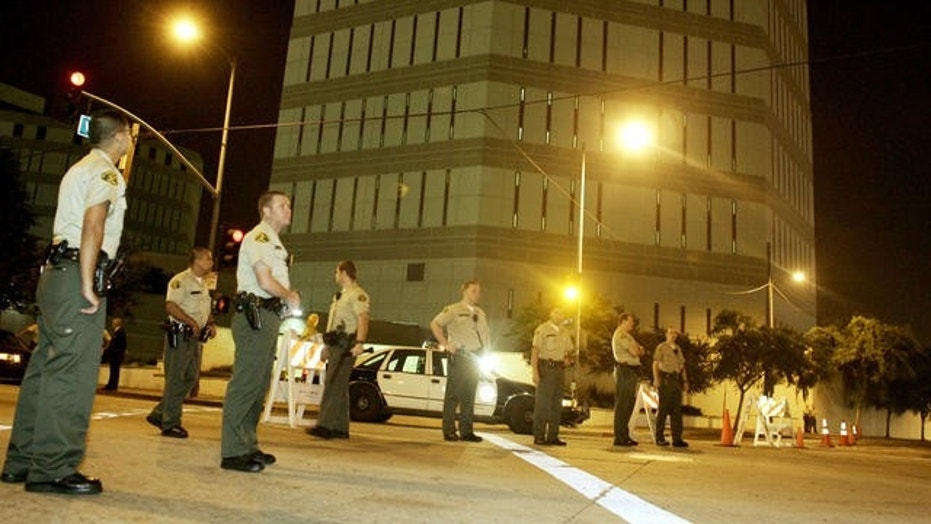 Los Angeles Sheriff's Department officers stand guard outside the Twin Towers Correctional Facility, Aug. 20, 2006.