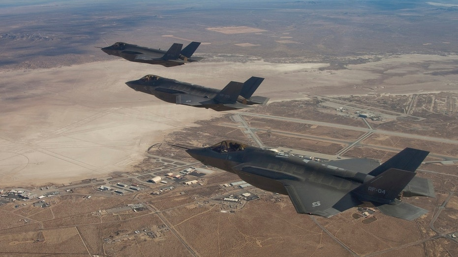 Three F-35 Joint Strike Fighters (rear to front) AF-2, AF-3 and AF-4, can be seen flying over Edwards Air Force Base, Dec. 10, 2011