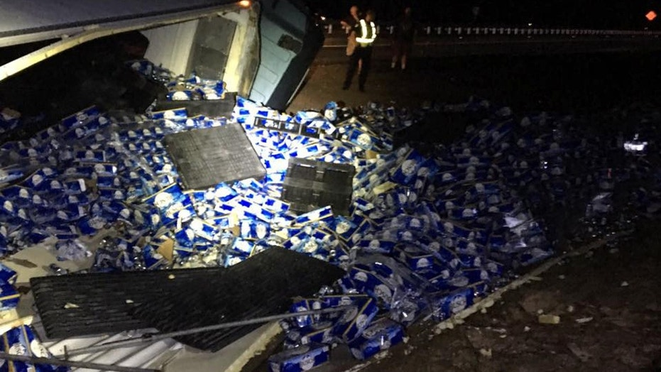 60000 pounds of beer spilled on FL interstate after semi overtu