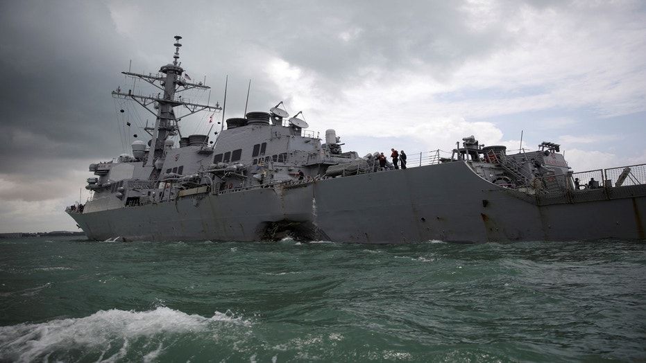 The U.S. Navy guided-missile destroyer USS John S. McCain is seen after a collision, in Singapore waters, Aug. 21, 2017.