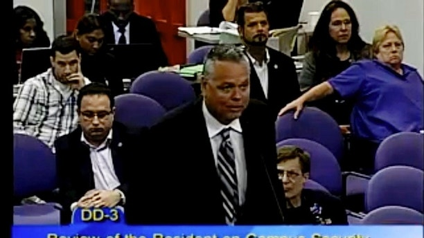 "This Feb. 18, 2015 image taken from video provided by Broward County Public Schools shows school resource officer Scot Peterson during a school board meeting of Broward County, Fla. During the shootings at Marjory Stoneman Douglas High School on Feb. 14, 2018, Peterson took up a position viewing the western entrance of the building for more than four minutes after the shooting started, but ""he never went in,"" Broward County Sheriff Scott Israel said at a news conference.  Peterson, was suspended without pay and placed under investigation, then chose to resign, Israel said  (Broward County Public Schools via AP)"