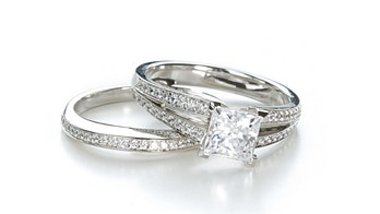 An engagement ring with a princess cut diamond and a wedding band.Click the image for jewelry and gemstone photos: