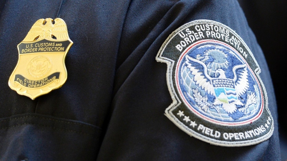 A U.S. Customs and Border Protection arm patch and badge is seen at Los Angeles International Airport, California February 20, 2014.