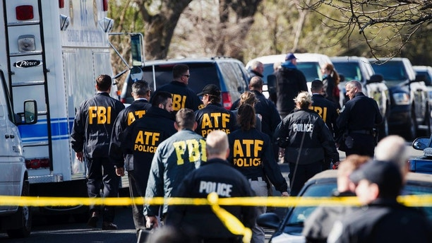 Authorities work on the scene of an explosion in Austin on Monday, March 12, 2018. Two package bomb blasts a few miles apart killed a teenager and wounded two women in Austin on Monday, less than two weeks after a similar attack left a man dead in another part of the Texas capital. (Ricardo B. Brazziell/Austin American-Statesman via AP)
