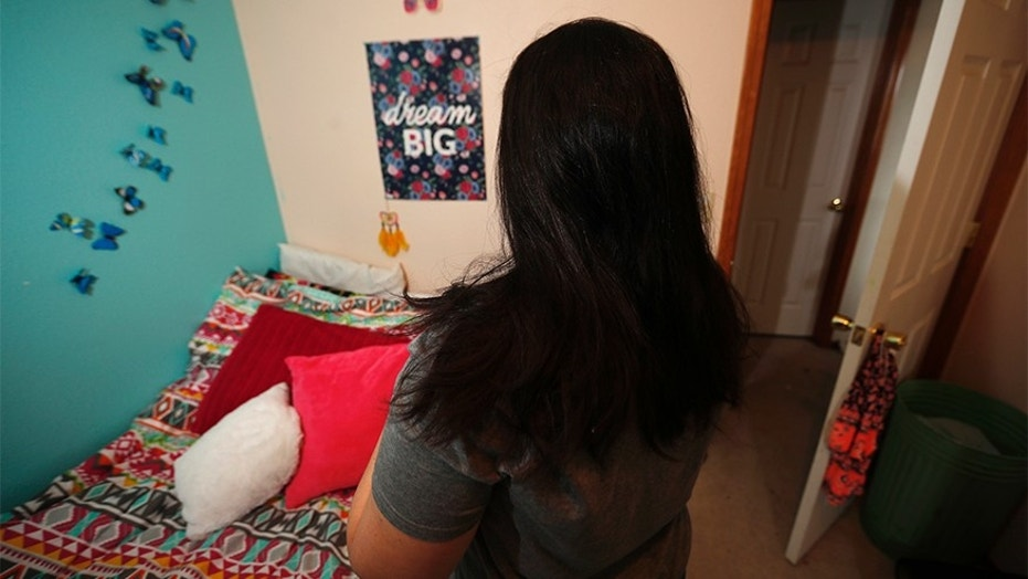 Jan. 31, 2018: A mother whose daughter said she was sexually assaulted during first grade by a classmate at their elementary school on a U.S. military base in Germany stands in her daughter's bedroom at their new home in Colorado.