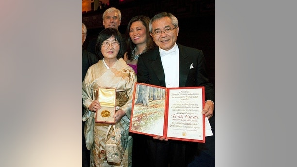 FILE - In this Dec. 10 2010, file photo, Japan's Ei-ichi Negishi, right, displays his Nobel diploma as his wife Sumire holds the medal after Negishi received the shared Nobel Prize for Chemistry from the Swedish King Carl Gustaf XVI at the Concert Hall in Stockholm, Sweden. Sumire Negishi was found dead Tuesday, March 13, 2018, in a northern Illinois landfill after her 82-year-old husband was found wandering a road south of Rockford, Ill., police said. (Scanpix Sweden, Henrik Montgomery via AP, File)