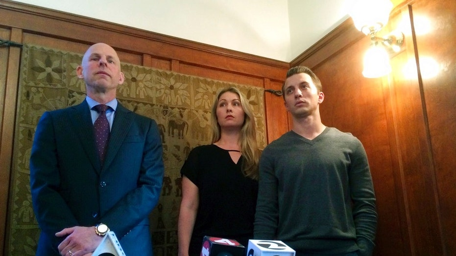 Denise Huskins and her boyfriend Aaron Quinn, right, who were wrongly accused of fabricating Huskins' kidnapping from their home, have reached a $2.5 million settlement with the city of Vallejo and its police department.