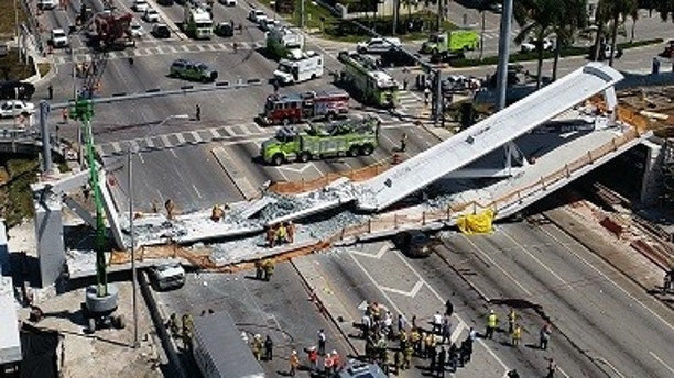 This photo provided by DroneBase shows the collapsed pedestrian bridge at Florida International University in the Miami area on Thursday, March 15, 2018. (DroneBase via AP)