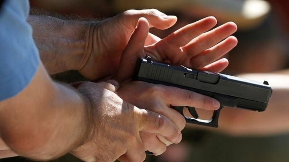 A New Jersey high school came under fire Friday after it allegedly suspended two students over a gun photo taken during a family visit to a shooting range.