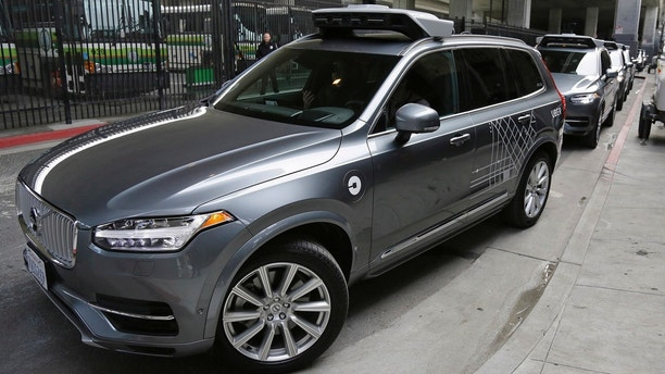 FILE - In this Dec. 13, 2016 file photo, an Uber driverless car heads out for a test drive in San Francisco. Police in a Phoenix suburb say one of Uber's self-driving vehicles has struck and killed a pedestrian. Police in the city of Tempe said Monday, March 19, 2018, that the vehicle was in autonomous mode with an operator behind the wheel when the woman walking outside of a crosswalk was hit. (AP Photo/Eric Risberg,File)