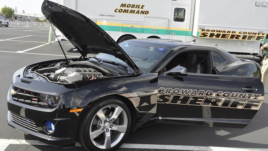 A woman suffered third-degree burns after intentionally slamming her car filled with accelerants into a Florida sheriff's office substation Monday, officials said.