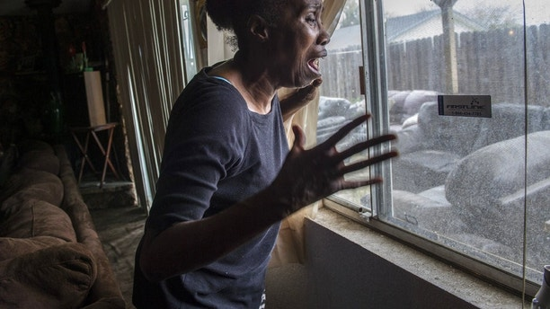 In this March 20, 2018 photo, Sequita Thompson, recounts the horror of seeing her grandson Stephan Clark dead in her backyard after he was shot by police in Sacramento, Calif. Relatives, activists and Sacramento officials are questioning why police shot at an unarmed black man 20 times, killing him, when he turned out to be holding only a cellphone in his grandparents' backyard. (Renee C. Byer/The Sacramento Bee via AP)