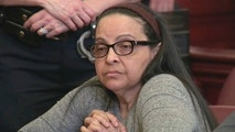 In this image from video, Yoselyn Ortega, a trusted nanny to a well-to-do family, listens to court proceedings during the first day of her trial,in New York, Thursday, March 1, 2018.  In October 2012 Ortega took two young children in her care into a bathroom at their Manhattan apartment, slaughtered them with a knife and then slit her own throat. (WYNY-TV/Pool Photo via AP)