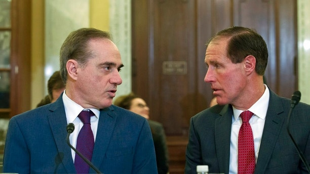 Veterans Affairs Secretary David Shulkin, left, speaks with Chief Financial Officer of the Department of Veterans Affairs Jon Rychalski during a hearing on FY2019 and FY2020 budgets for veterans programs, before the Senate Committee on Veterans Affairs on Capitol Hill, Wednesday, March 21, 2018, in Washington. (AP Photo/Jose Luis Magana)