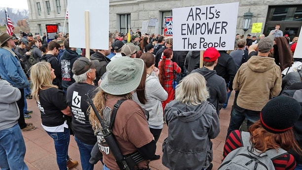Pro-gun marchers gather during a rally designed by organizer to advocate for fortified schools and more armed teachers Saturday, March 24, 2018, at the Utah State Capitol, in Salt Lake City. Hundreds of people were expected to march to the Capitol in separate protests aimed at improving school safety, in very different ways. Pro-gun marchers will advocate Saturday for fortified schools and more armed teachers, while Utah students will take to the street as part of rallies being held around the country to urge lawmakers to pass gun regulations.
