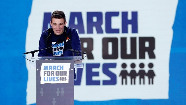 """Cameron Kasky, a student at the Marjory Stoneman Douglas High School, site of a February mass shooting which left 17 people dead in Parkland, Florida, speaks during the """"March for Our Lives"""" event demanding gun control after recent school shootings at a rally in Washington, U.S., March 24, 2018. REUTERS/Aaron P. Bernstein - HP1EE3O1A2XD6"""
