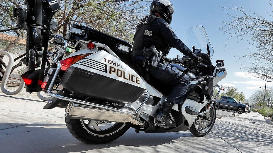 A Tempe, Ariz. police officer displays his AR-15 rifle that is carried on his motorcycle Tuesday, March 27, 2018. Tempe police have equipped eight motorcycle officers with AR-15 rifles and have stated that the weapons provide added security to ensure the officers are not outgunned by suspects.