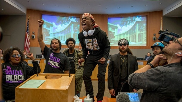 Stevante Clark, brother of Stephon Clark stormed the Sacramento City Council chambers briefly forcing the council to leave the chambers on Tuesday, March 27, 2018.  (Jose Luis Villegas /The Sacramento Bee via AP)