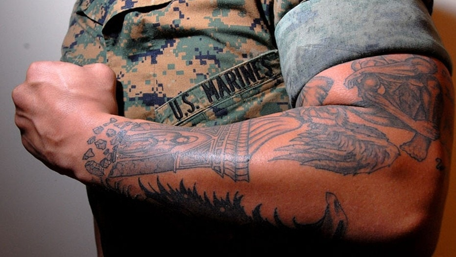"Lance Cpl. Tom Blachard showing his tattoo ""sleeves"" that cover one of his arms. The Marines have just eased up on their tattoo rules."