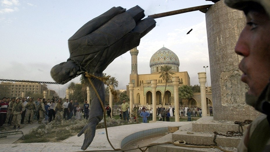 The toppled statue of Saddam Hussein is seen in Firdos Square downtown Baghdad in this April 9,  2003 file photo.