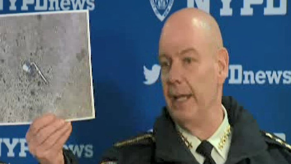 "NYPD Chief of Department Terence Monahan at a press conference on Wednesday showing what 911 callers had described as a ""silver firearm"" that a man was pointing at people on the street."