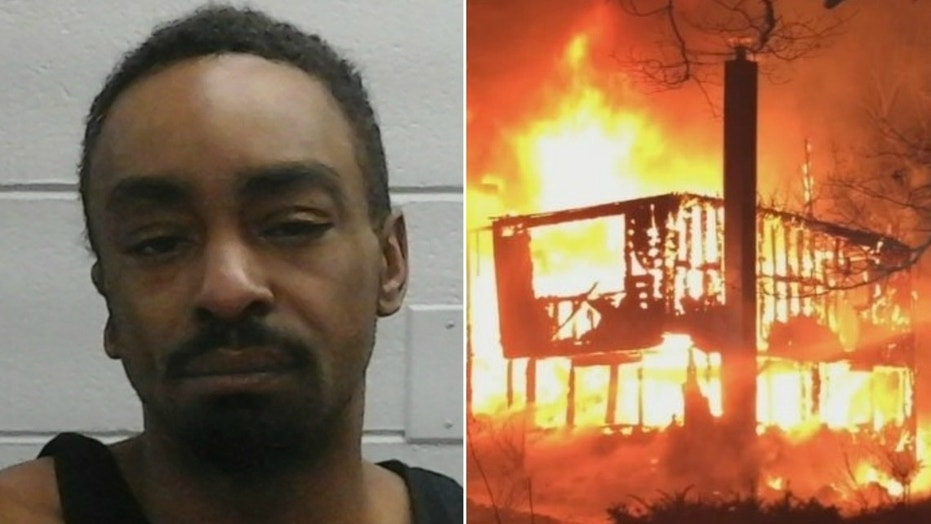 Police said Mondel Johnson attacked a woman with a hammer before he doused her with a fluid and set a house on fire with her in it.