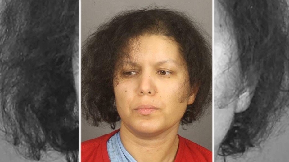 Mugshot for Hanane Mouhib, 36, who has been charged with decapitating her 7-year-old son Abrahma Cardenas in upstate New York.