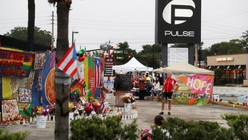 A guest strolls through the parking lot outside the Pulse Nightclub on the one year anniversary of the shooting, in Orlando, Florida, U.S., June 12, 2017. REUTERS/Scott Audette - RC1C81D7DF00