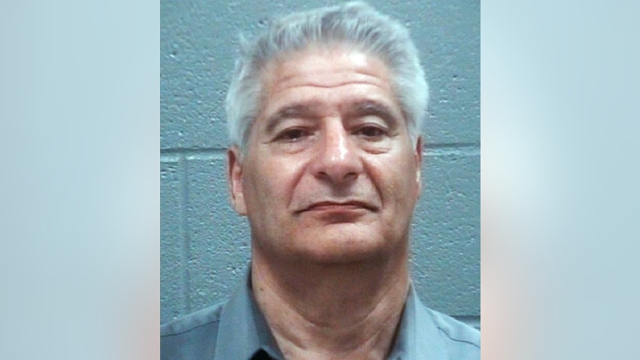 Steven F. Hoppenbrouwer was charged with driving under the influence after the charter bus he was driving to the Masters golf tournament overturned on a Georgia interstate Thursday, April 5, 2018, injuring passengers.