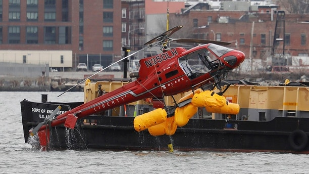 The wreckage of a chartered Liberty Helicopters helicopter that crashed into the East River is hoisted from the water in New York, U.S., March 12, 2018. REUTERS/Shannon Stapleton     TPX IMAGES OF THE DAY - RC1703685560